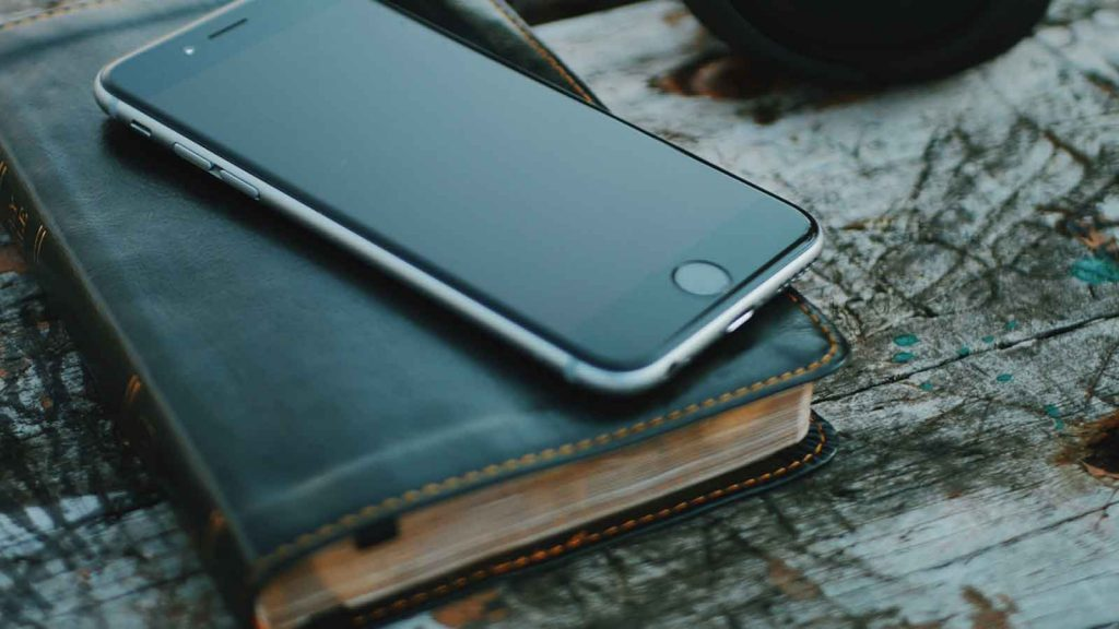 Picture of the Bible and a smartphone.